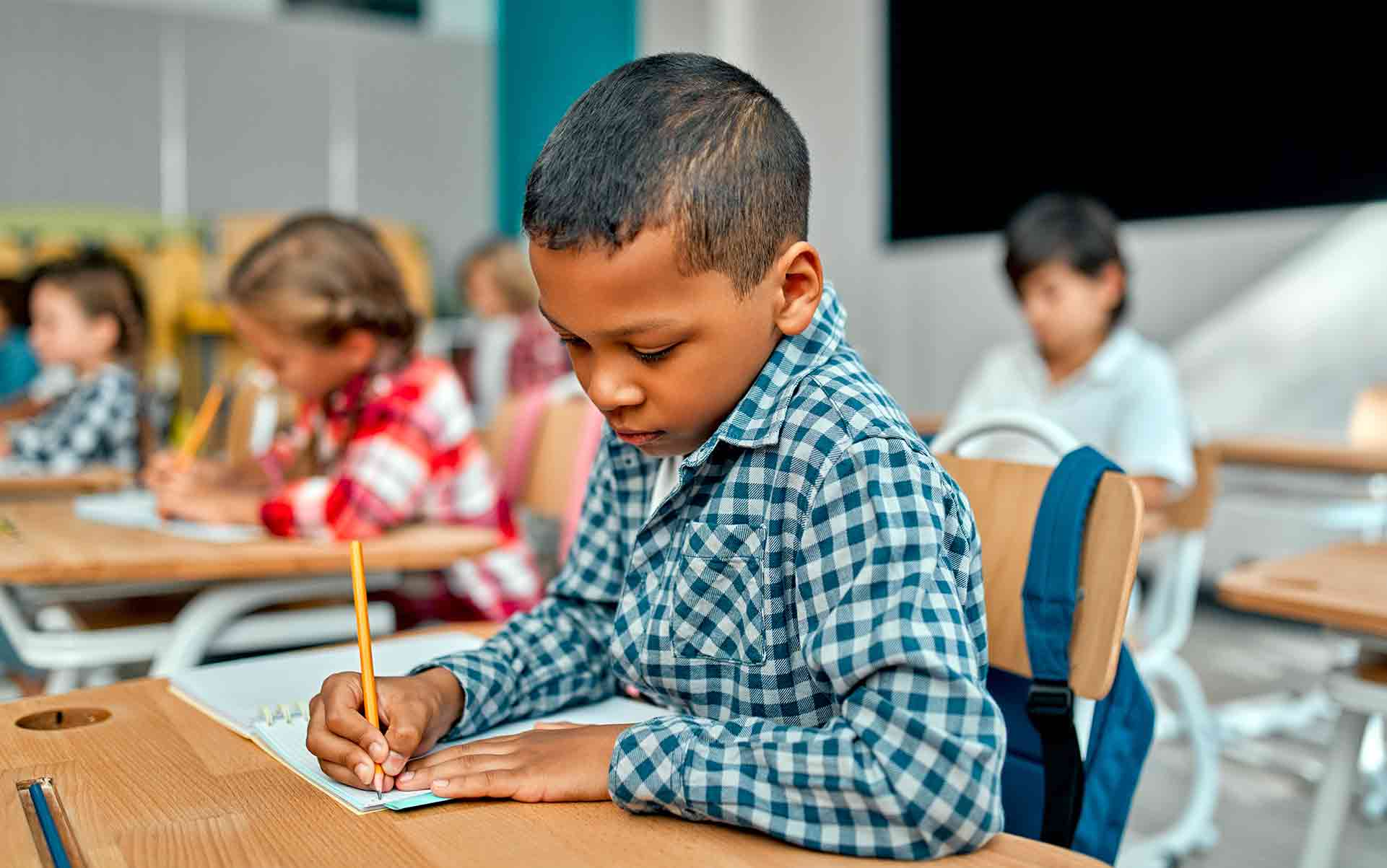 A Child Preparing For His SATs Exam With Gloucestershire Primary Tutors